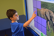 Child Playing on Smart Board