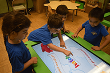 Kids playing on Smart Table